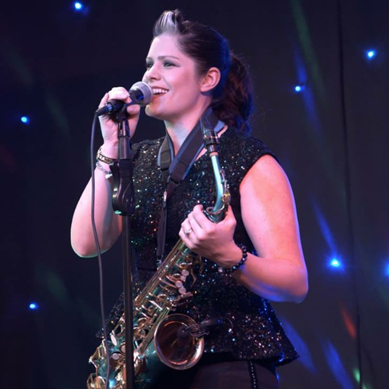 singer and saxophone player performing live on stage