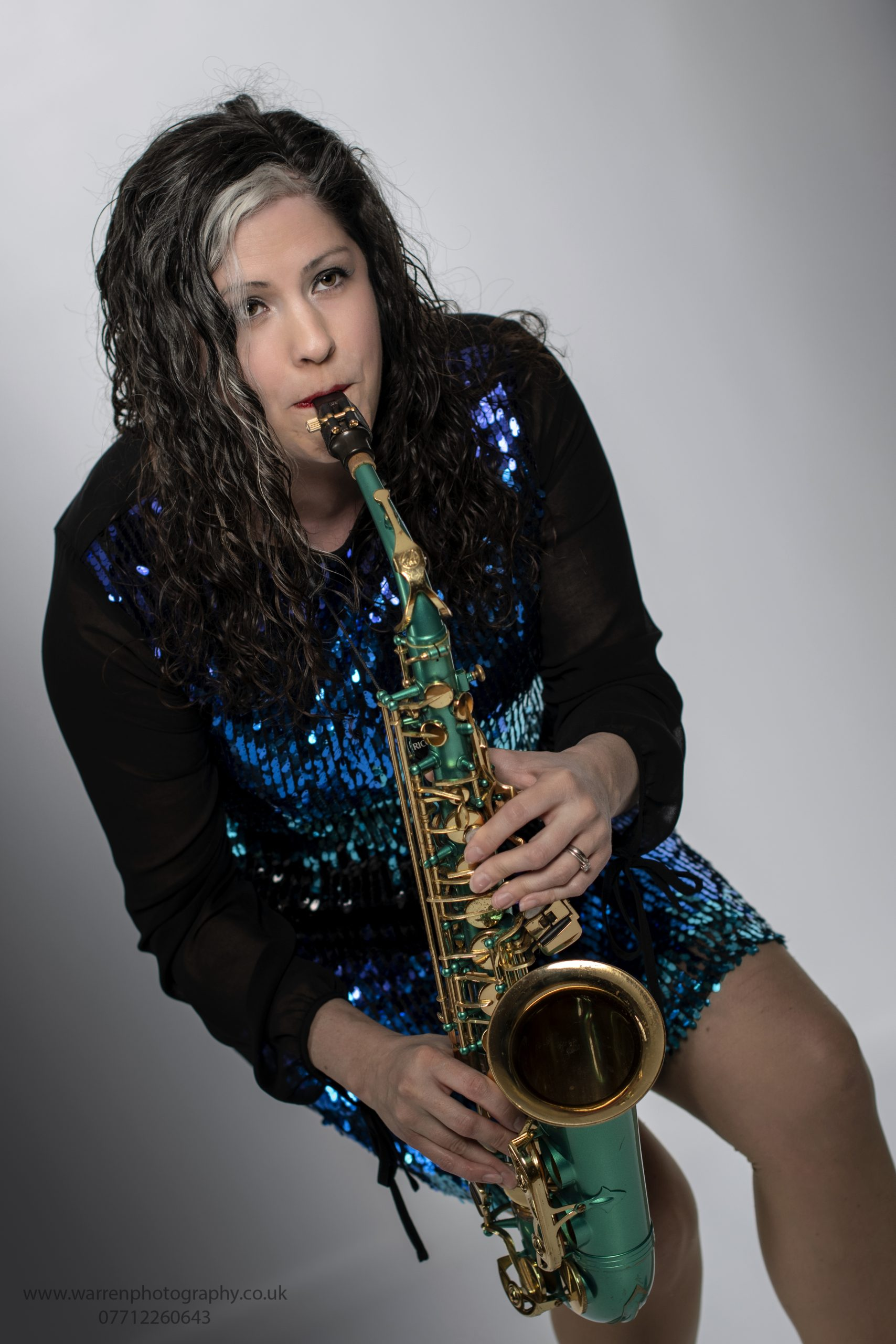 sax girl playing bent down