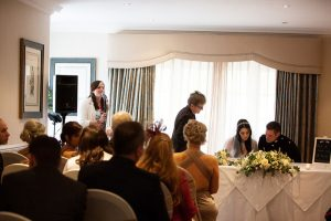wedding singer performing to couple as they sign the register